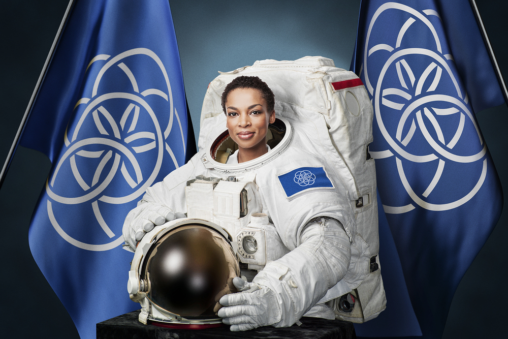 patriotic cosmopolitanism - astronaut with international flag of planet earth designed by Oskar Pernefeldt