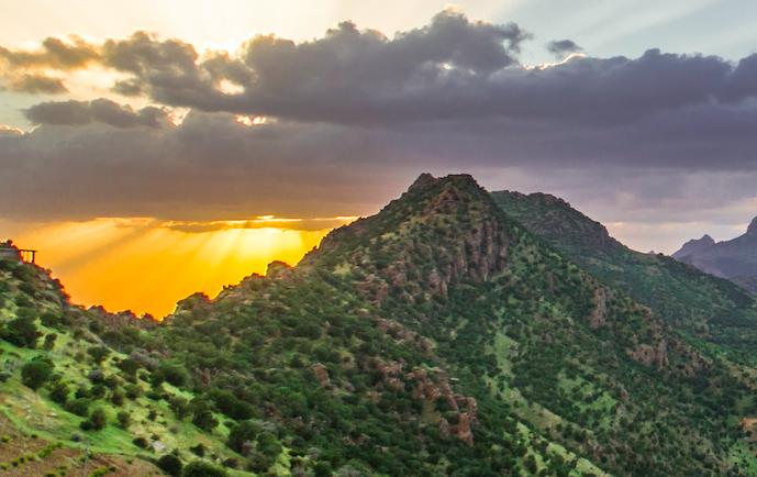 Baha'u'llah in wilderness of Kurdistan - calligrapher on the mountain